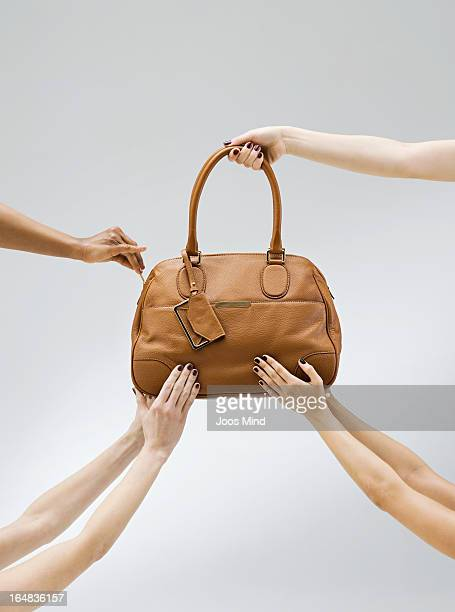female hands holding a handbag - clutch bag stock pictures, royalty-free photos & images
