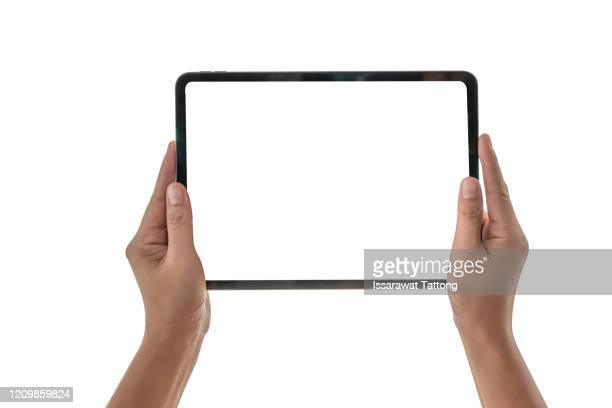 female hands holding a tablet computer gadget with isolated screen - ipad stock pictures, royalty-free photos & images