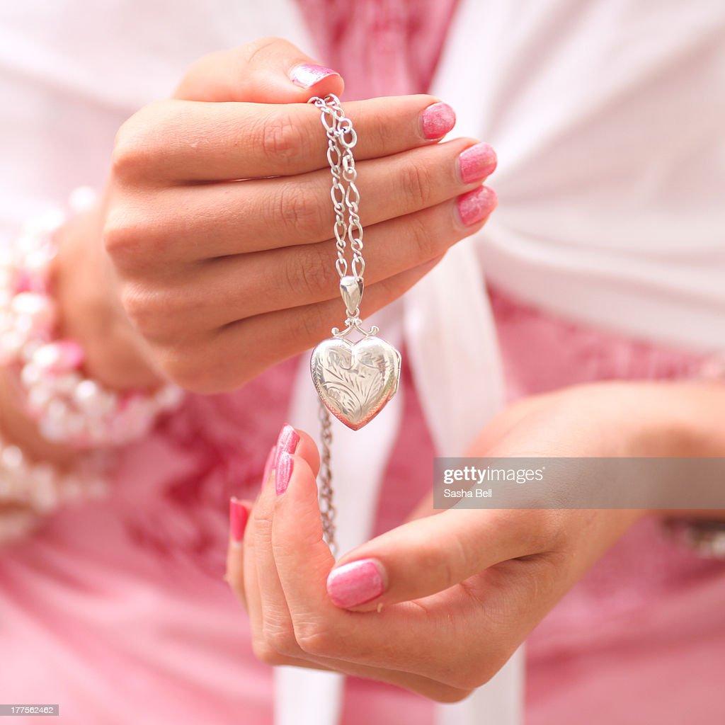 Female Hands Holding Heart Locket : Stock Photo