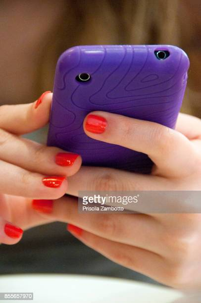 Female hands holding mobile phone