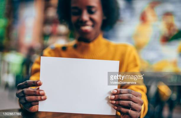 female hands holding white empty blank paper page with copy space. - copy space imagens e fotografias de stock