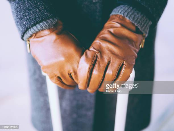 female hands in leather gloves grabbing suitcase - leather glove stock pictures, royalty-free photos & images