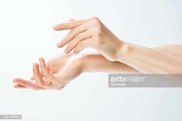 female hands on a white isolated background - 手 ストックフォトと画像