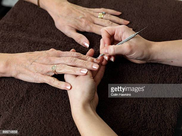 female hands receiving manicure