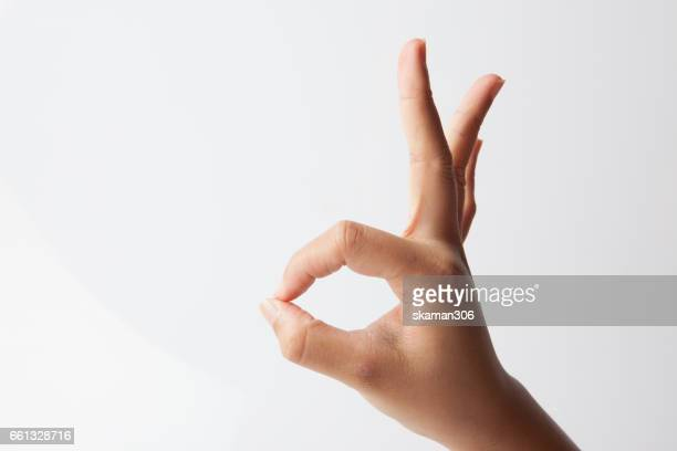 Female hands show OK sign