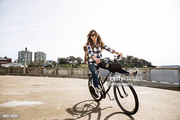 a female having fun on a bike - only mid adult women stock pictures, royalty-free photos & images