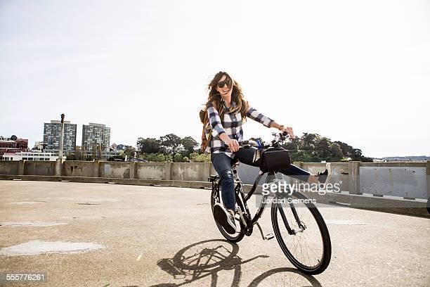 a female having fun on a bike - radfahren stock-fotos und bilder