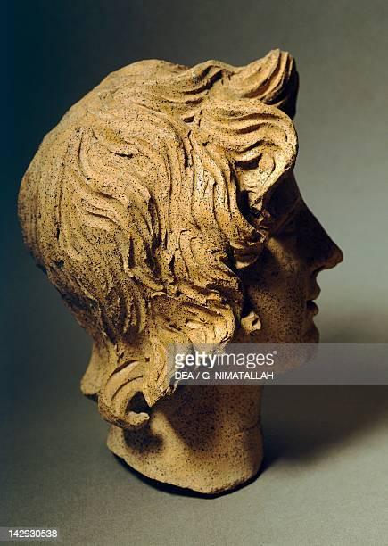 Female head, terracotta sculpture from the site of Lavinium-Pratica di Mare, Lazio, Italy. Latin Civilization, 5th Century BC. Pomezia Pratica Di...