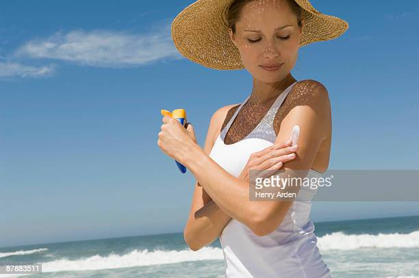 female health beauty - sunscreen stock photos and pictures