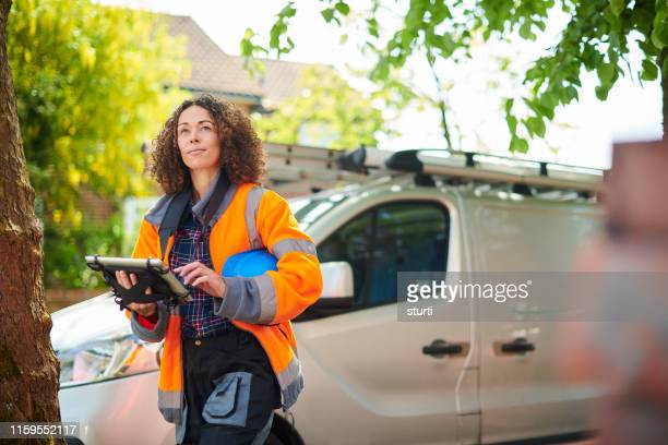 female heating engineer arrives at job - commercial land vehicle stock pictures, royalty-free photos & images