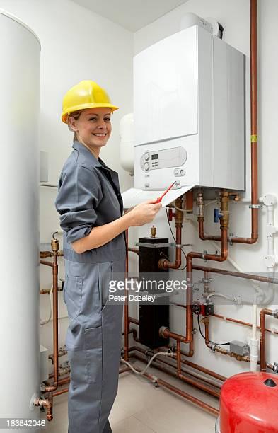 Female heating engineer smiling