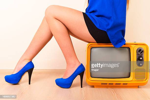 female  hegemony - legs and short skirt sitting down stock photos and pictures