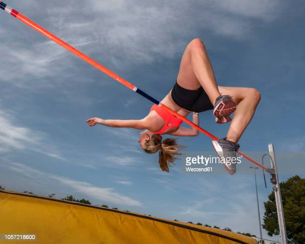 female high jumper - high jump stock pictures, royalty-free photos & images