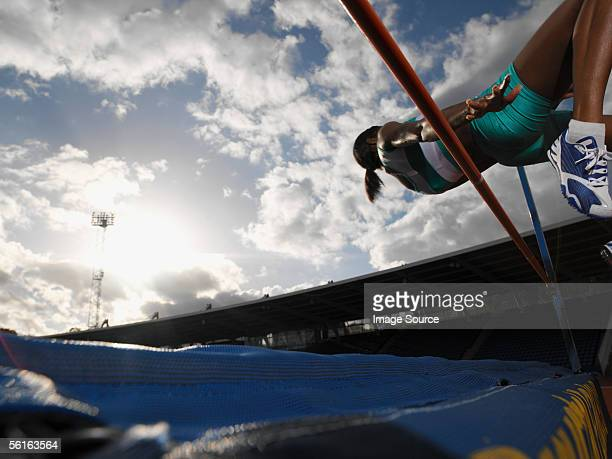 female high jumper - women's field event stock pictures, royalty-free photos & images