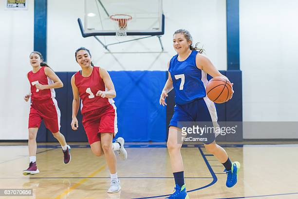 female high school basketball player dribbling to hoop - composition stock pictures, royalty-free photos & images