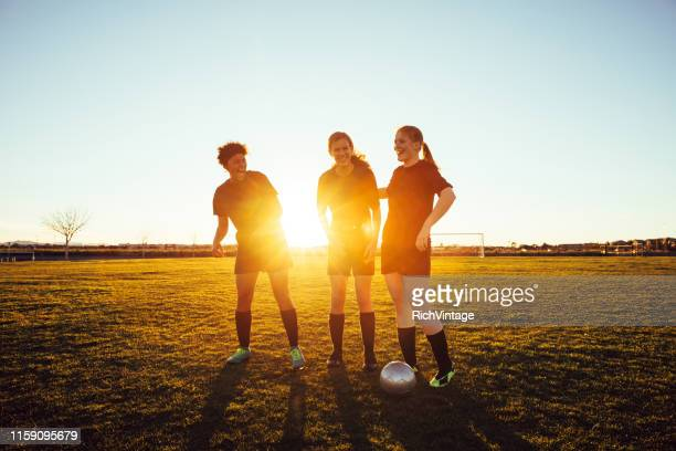 female high school soccer players - high school football stock pictures, royalty-free photos & images
