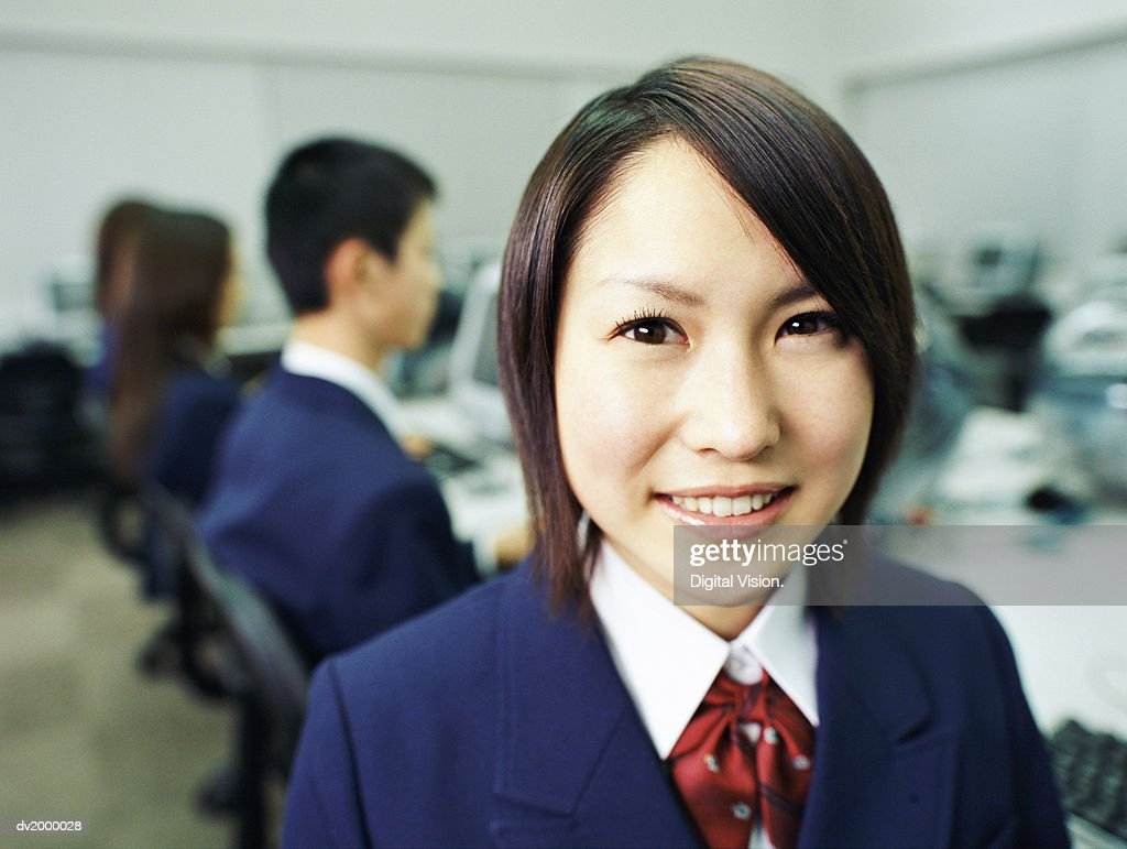 Female High School Student in a Computer Classroom : Stock Photo