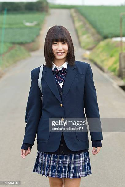Female High School Student Standing on Rural Road