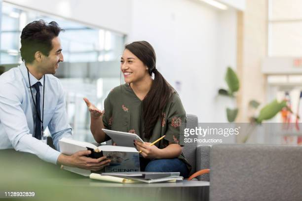 female high school student talking with teacher - idol stock pictures, royalty-free photos & images
