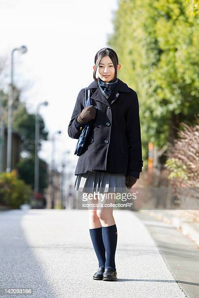 female high school student walking - female high school student stock pictures, royalty-free photos & images