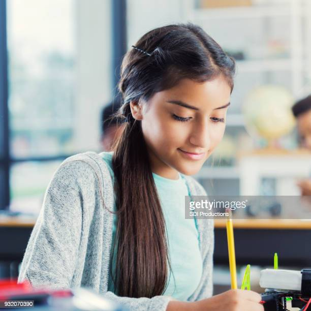 Female high school student works on class assignment