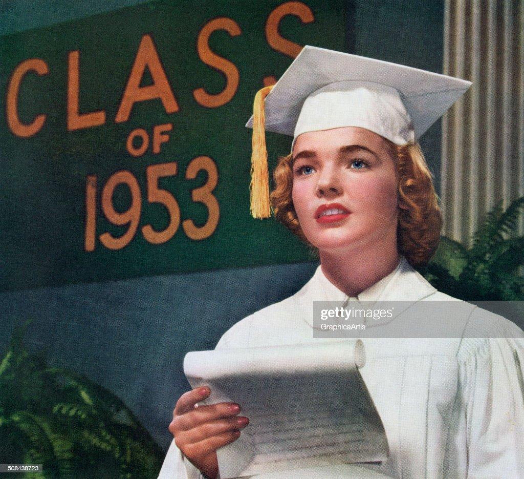 Female high school valedictorian addresses her class, 1953. Screen print.