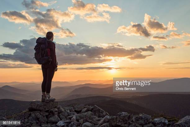female hiker admiring scenic sunset from top of mount abraham, maine, usa - appalachian trail stock pictures, royalty-free photos & images