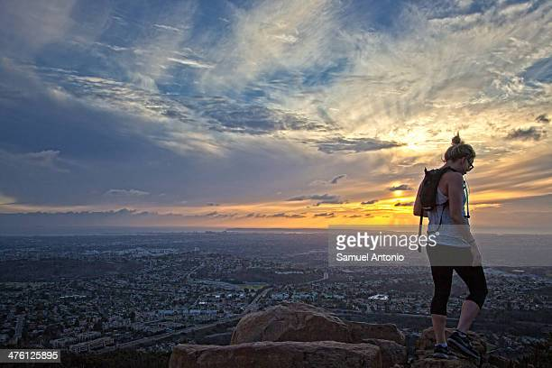 Female hiker at Cowles Mountain summit during sunset. Taken February 2014. Adult, Beautiful People, Beauty, Beauty In Nature, Cloud, Cloudscape, Copy...