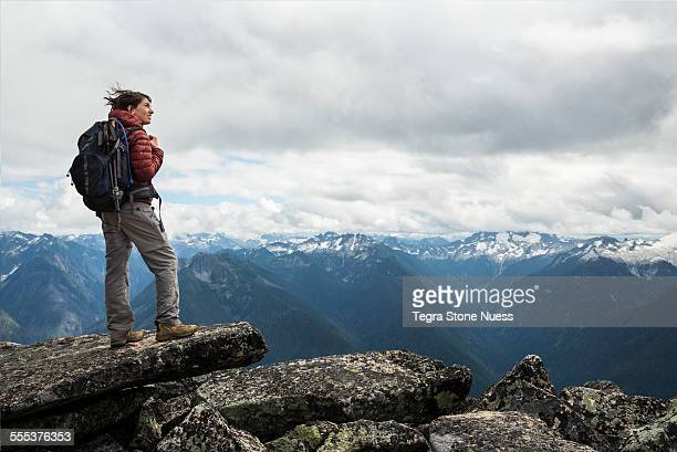 female hiker at summit - explorer stock pictures, royalty-free photos & images