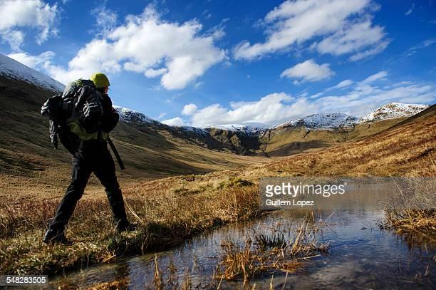 A female hiker at The Loch Lomond & The Trossachs National Park, Scotland, UK.