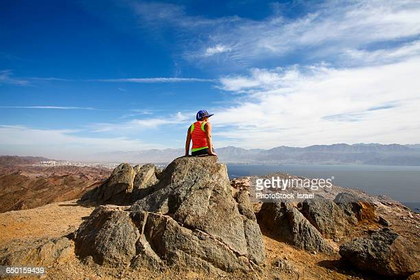Female hiker enjoying the view from a summit of the Eilat mountains, Israel