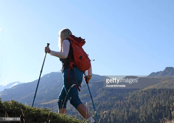 female hiker explores mountains - pedal pushers stock pictures, royalty-free photos & images