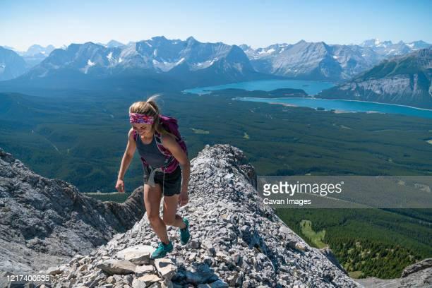 female hiker high above kananaskis country in alberta - スクランブリング ストックフォトと画像