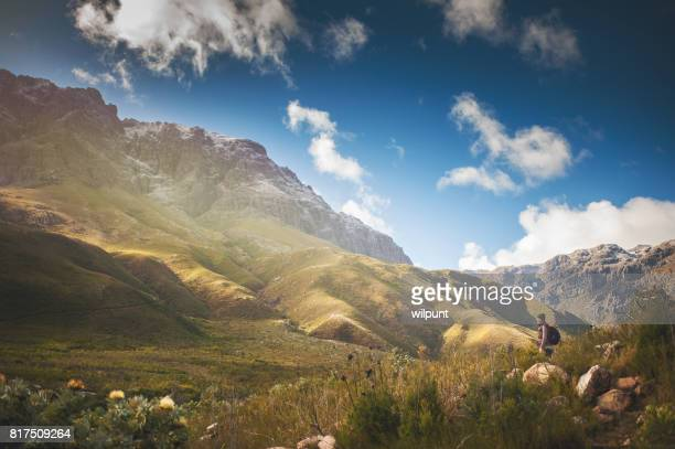 female hiker in between snow capped mountains - western cape province stock pictures, royalty-free photos & images