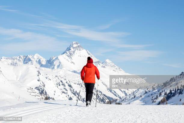 Female Hiker in Winter Mountains