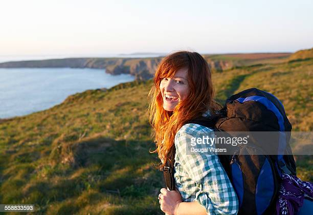 Female hiker laughing