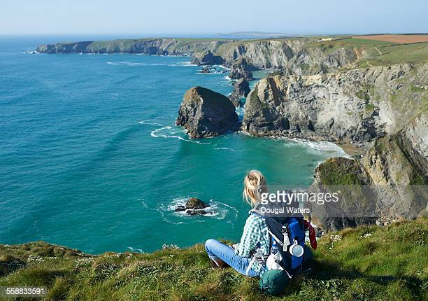 Female hiker looking along Atlantic coastline