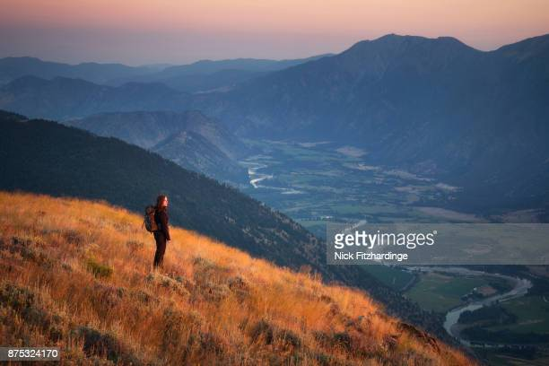 female hiker looking at sunset with the similkameen valley behind, british columbia, canada - thompson okanagan region british columbia stock pictures, royalty-free photos & images