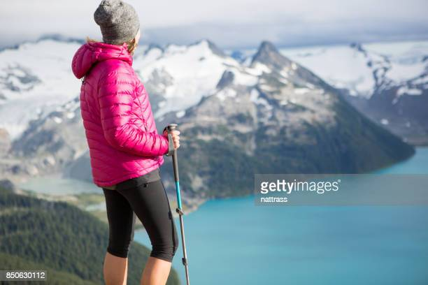 female hiker looking at the view - garibaldi park stock pictures, royalty-free photos & images