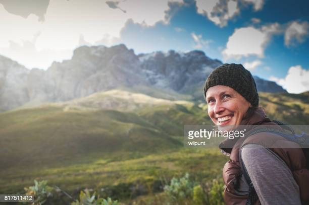 female hiker looking bcak - women's issues stock photos and pictures