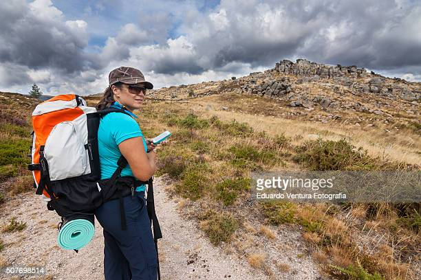 Female hiker looks back on the hard trail