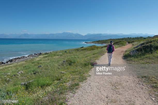 female hiker on corfu coastline, corfu, greece - greece v albania stock pictures, royalty-free photos & images