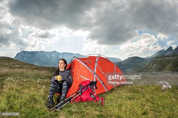 Female hiker on mountain meadow