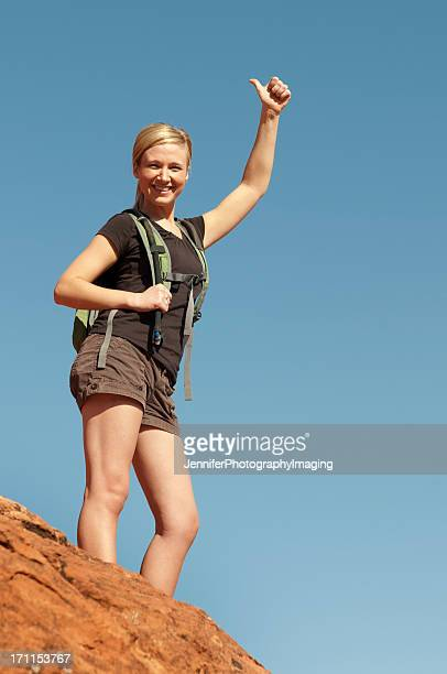 Female Hiker on Top of a Hill