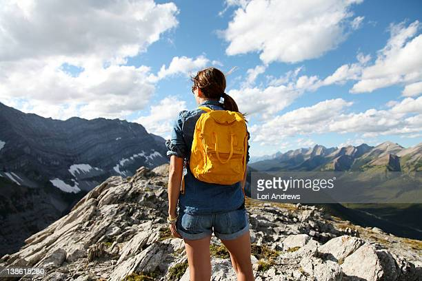 Female hiker on top of mountain with yellow pack