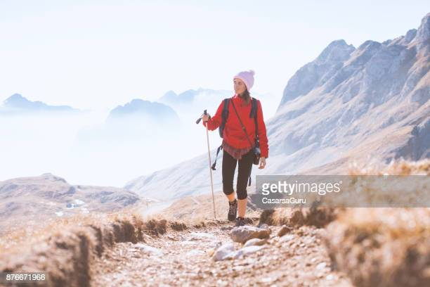 female hiker on trail to the mountain mangart, slovenian alps - slovenia stock pictures, royalty-free photos & images