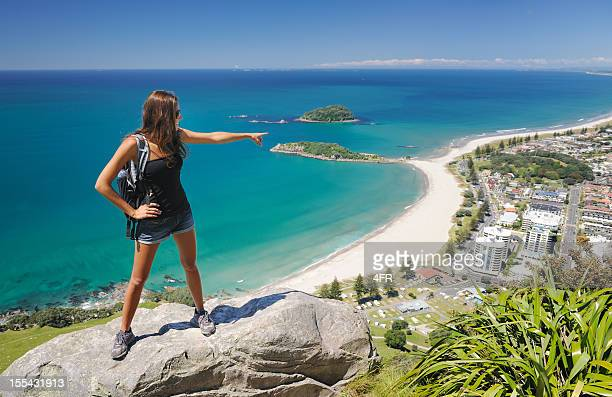 Female Hiker overlooking Mt. Maunganui, Bay of Plenty, New Zealand