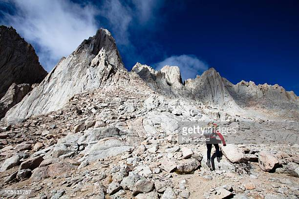 a female hiker scrambles up the mountaineer's route of mount whitney, california. - lone pine california stock pictures, royalty-free photos & images