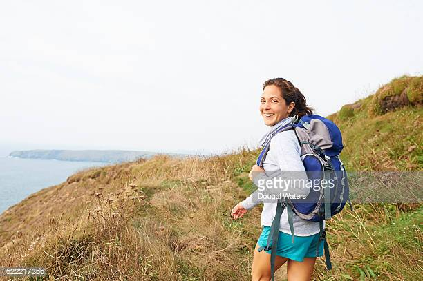 Female hiker smiling.