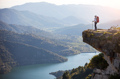 Female hiker standing on cliff 494311501